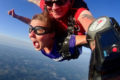 Kaila Proulx gives thumbs up skydiving the first time