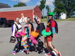 Four skydivers dressed in colorful clothing.
