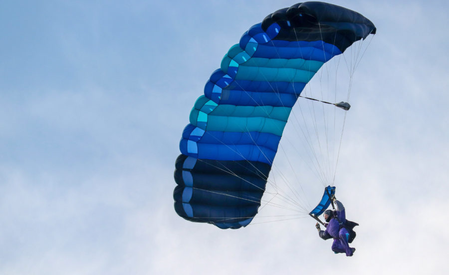Example of a skydiver under main canopy, showcasing how parachutes work.
