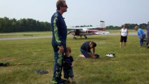 Skydiver packing parachute and 85D skydiving airplane