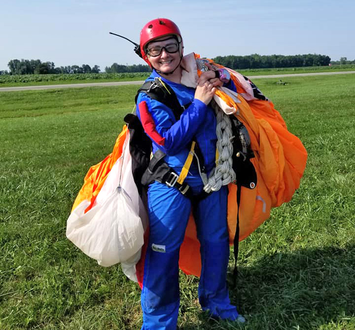 Happy student having completed her skydiving certification A license