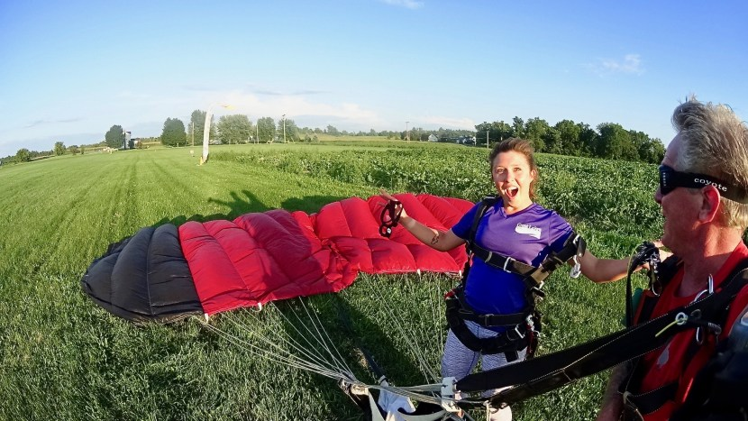 Kaila after her first skydiving experience - back on the ground and so happy!