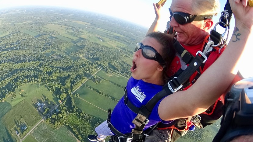 Kaila experiencing the rush of tandem skydiving