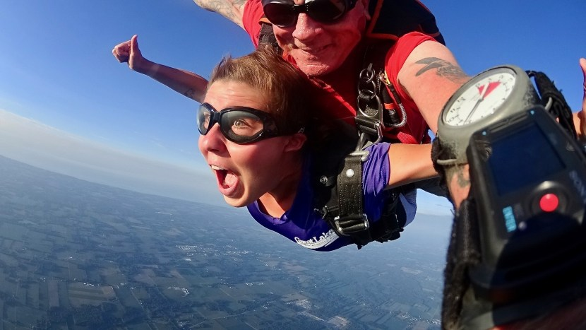 Kaila Proux and her tandem skydiving instructor in mid-flight