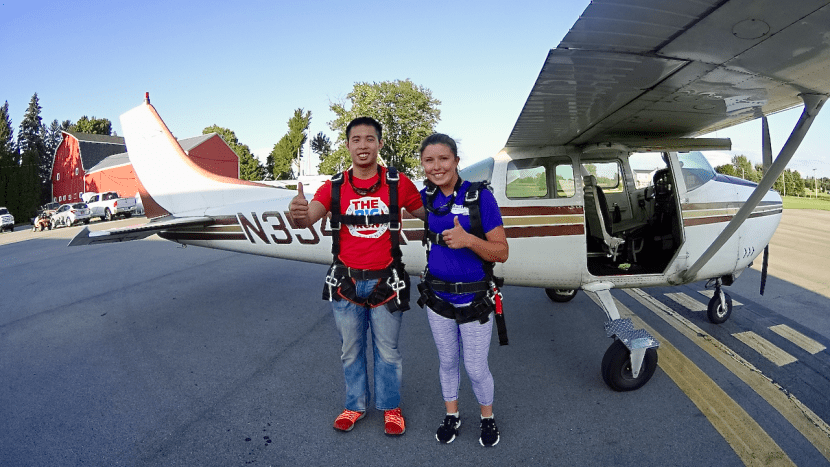 Kaila Proulx and her friend are in harness and ready for their first skydiving experience.