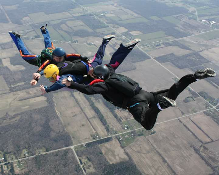 AFF student and instructors in freefall.