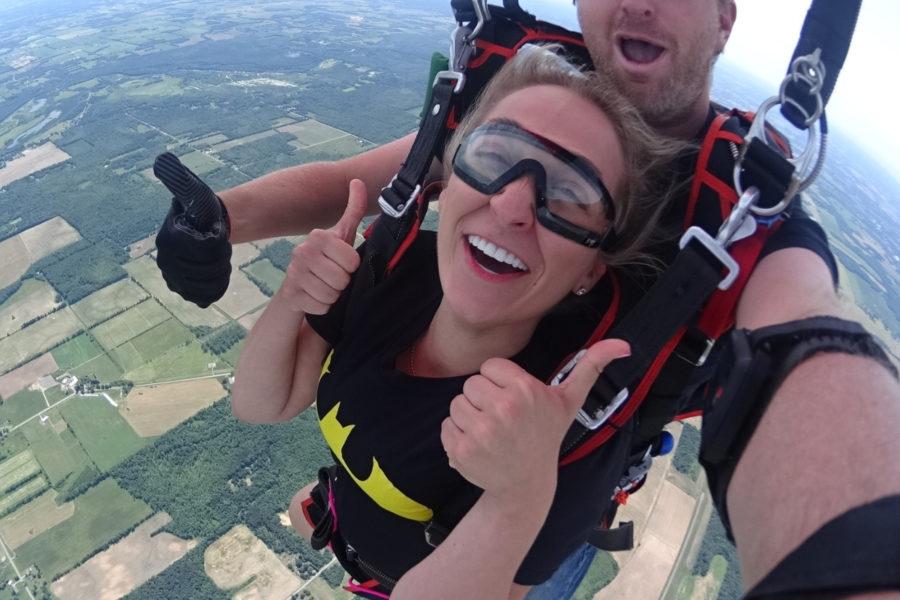 Tandem skydiver under canopy