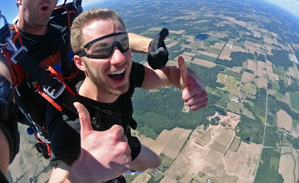 Young man on his first tandem skydive