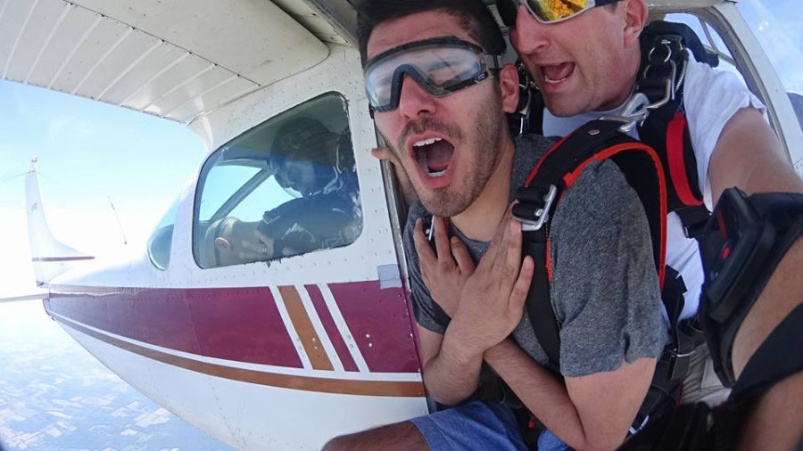 Man breathing and hollering while exiting skydiving plane
