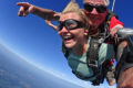 Young female skydiver jumping on a perfect skydiving weather day.