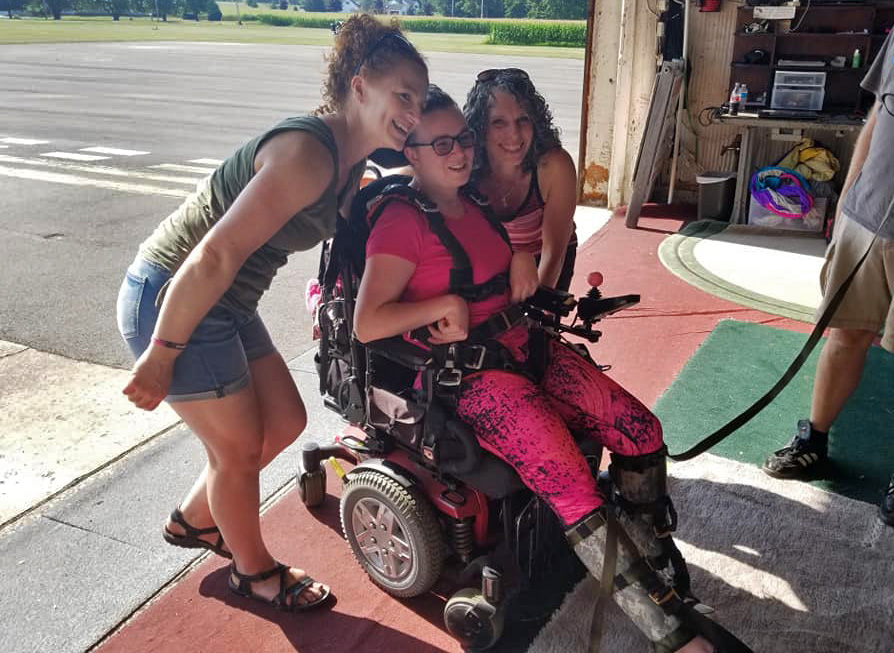 Paraplegic skydiver Naomi gets prepared for her birthday skydive with her sister.