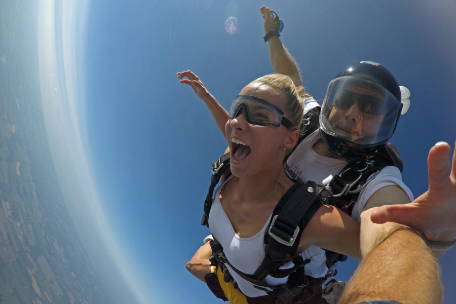 Tandem student in skydiving freefall.