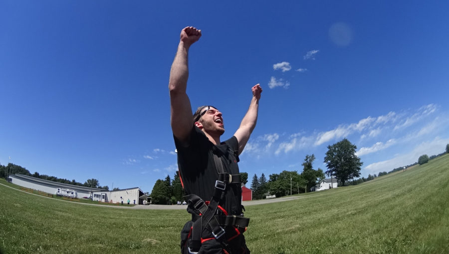 Victorious skydiver after successful tandem skydiving landing